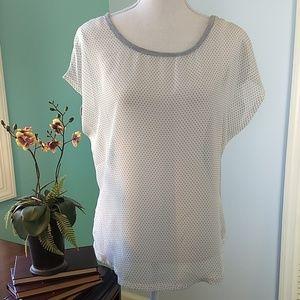 3/$25  Black/cream polka dot top. Lace back.